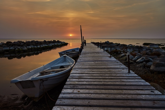 Beautiful sunset view with wooden jetty