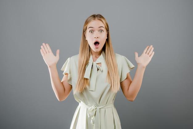Beautiful surprised blonde girl isolated