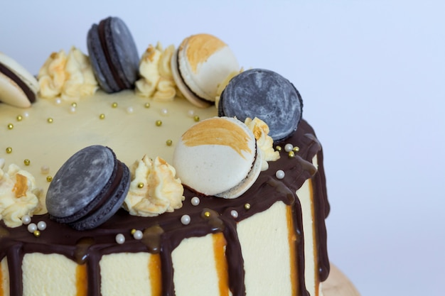 Beautiful sweet cake, close up of cake with macaroons