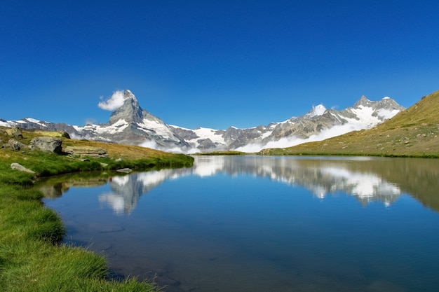 Beautiful swiss alps landscape with stellisee lake and matterhorn mountain reflection in water