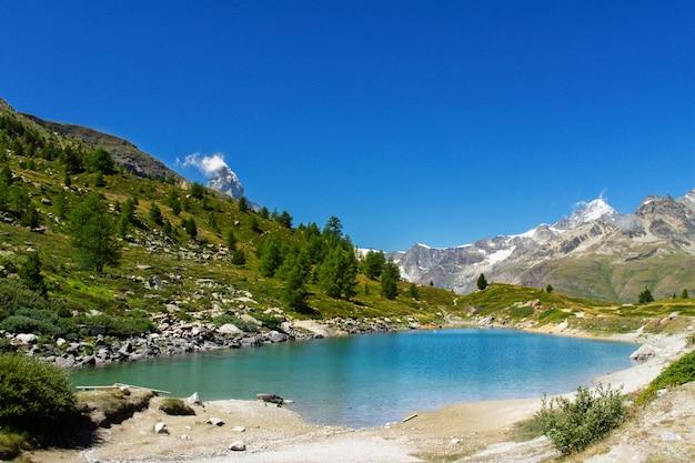 Beautiful swiss landscape with stellisee lake and matterhorn mountains
