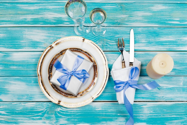 Beautiful table setting on blue wood