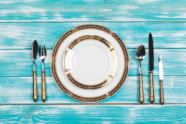Beautiful table setting on blue wooden surface