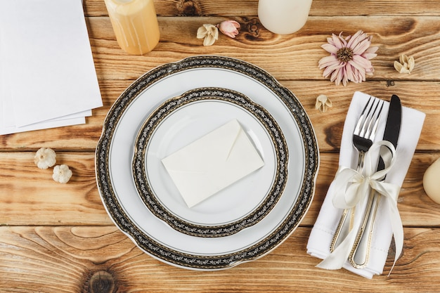 Beautiful table setting on wooden table from above