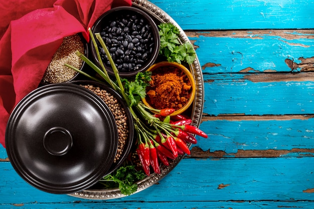Beautiful tasty appetizing ingredients spices grocery red chilli pepper black bowls for cooking healthy kitchen.