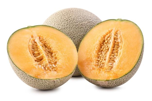 Beautiful tasty fresh ripe rock cantaloup melon fruit with seeds isolated on white.