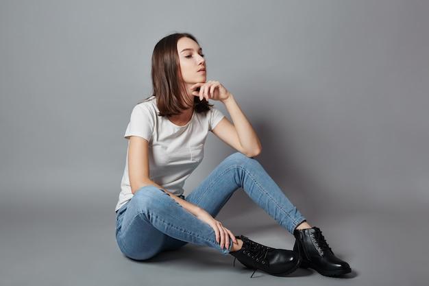 Beautiful teen girl smiling sitting on floor