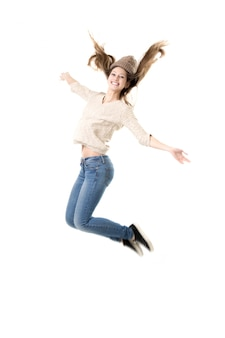 Beautiful teenage girl jumping high with delight