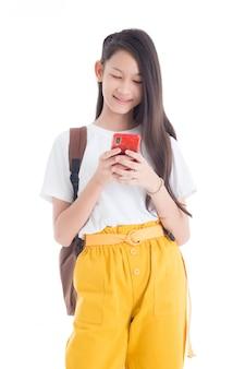 Beautiful teenage girl using smart phone isolated over white background