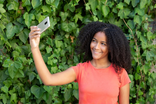 Beautiful teenager girl with a mobile