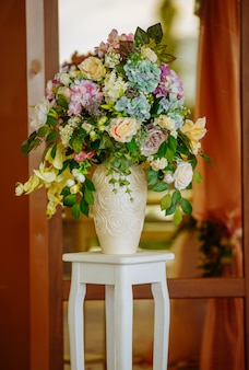 Beautiful tender bouquet on elegant white stand
