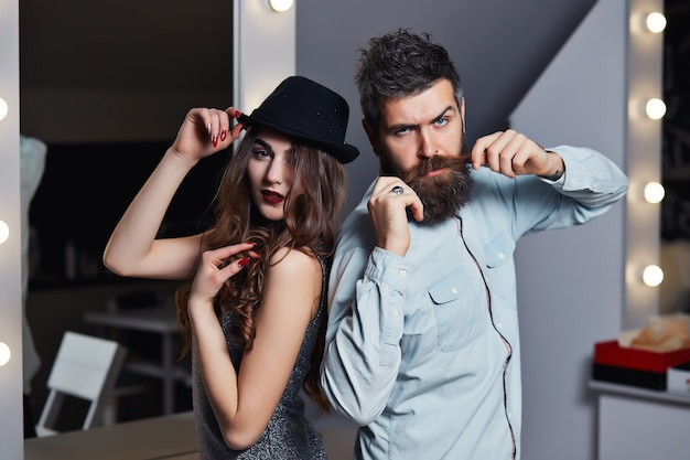 Beautiful tender girl near bearded man