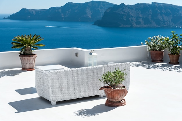 Beautiful terrace in santorini with view on the volcano
