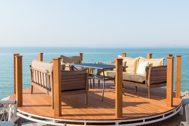 Beautiful terrace with table, sofas and armchair. great sea view