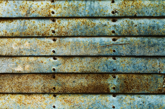 Beautiful texture of grunge rusty stripes wall. horizontal. pattern. rusty background. blue turquoise.