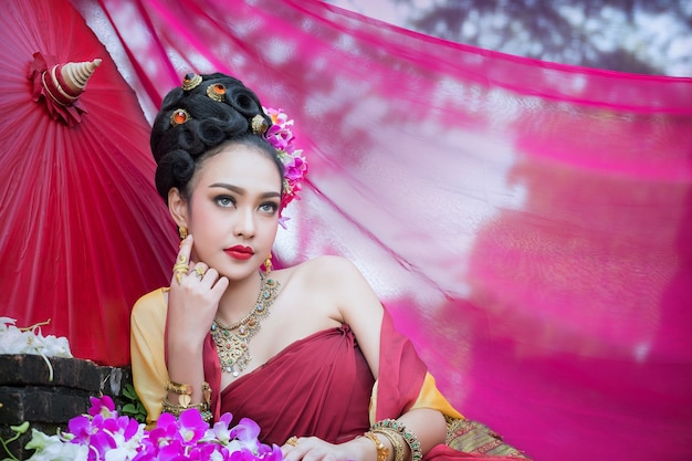 Beautiful thai girl in traditional dress costume in choeng