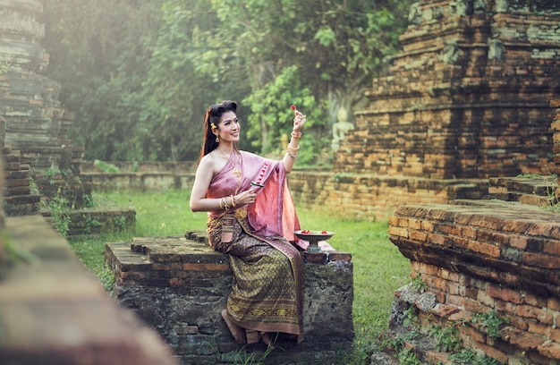 Beautiful thai girl in traditional dress costume