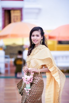 Beautiful thai woman in thai traditional costume at temple