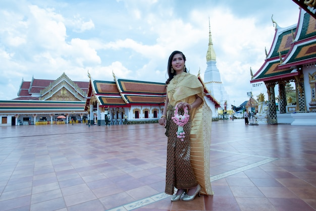 Beautiful thai woman in traditional dress costume at temple of thailand