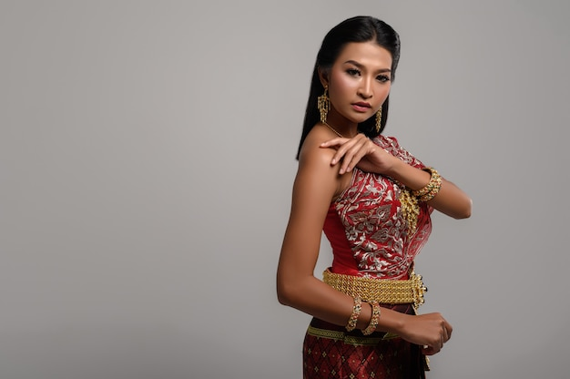 Beautiful thai woman wearing thai dress and looking to the side
