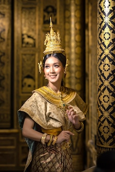 Beautiful thai women are dressing in traditional thai national costumes. to prepare for the pantomime drama scene