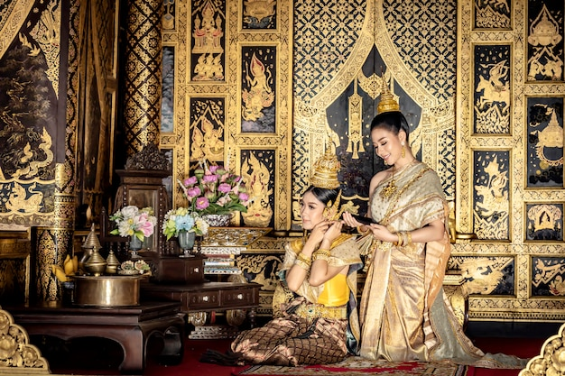 Beautiful thai women are dressing in traditional thai national costumes.