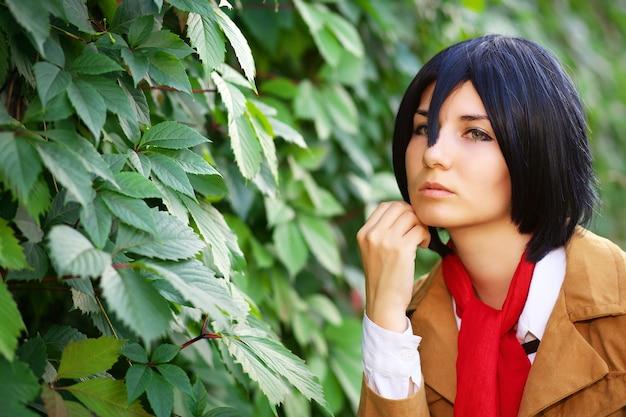 Красивая задумчивая девушка аниме персонаж возле листьев в парке
