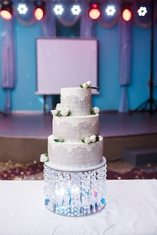 A beautiful three-tiered cake with a crystal.