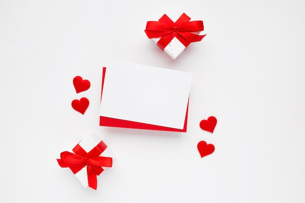 Beautiful top view of empty greeting card for valentines on white