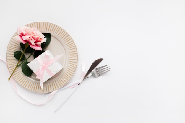 Beautiful top view table setting for valentines on white