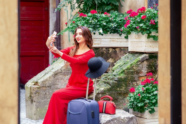 Beautiful tourist business woman is taking selfie by smartphone.