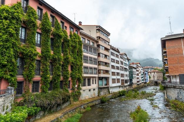 Beautiful traditional local houses in the town of azkoitia next to the urola river, gipuzkoa. basque country