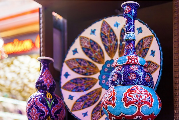 Beautiful traditional souvenirs at the bazaar colored ceramics decorated with a beautiful