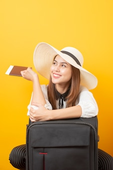 Beautiful traveler woman is exciting on yellow