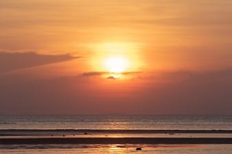 Beautiful tropical beach sunset with golden lights background, Koh Samui Thailand