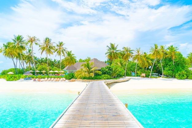Beautiful tropical maldives resort hotel and island with beach and sea, holiday vacation concep