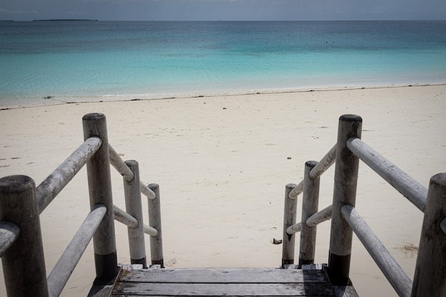 Beautiful tropical steps into turquoise sea water