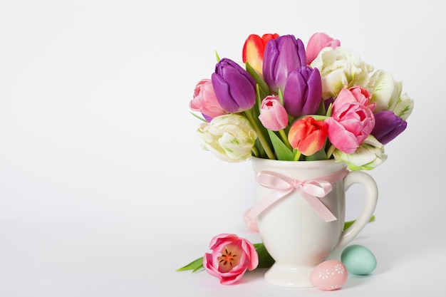 Beautiful tulips bouquet and easter eggs