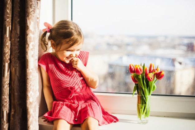 Beautiful tulips, spring flowers.tulips in a vase on the window