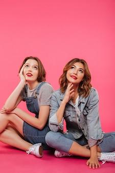 Beautiful two women friends dreaming.