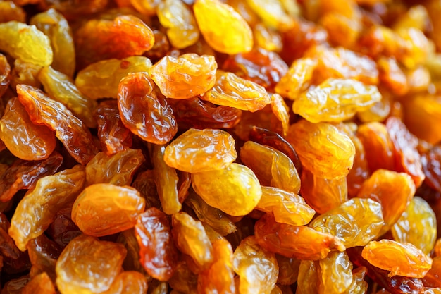 Beautiful and useful yellow dried raisins close-up view from the top