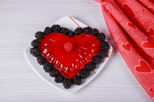 Beautiful valentines day with jelly in the form red hearts on white background