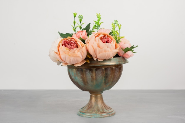 Beautiful vase of pink roses on grey surface