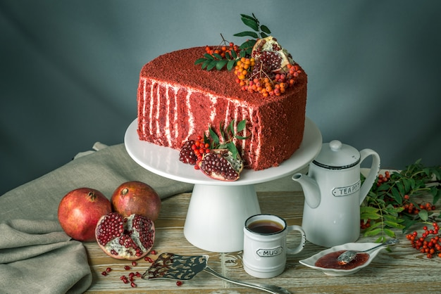 Beautiful velvet cake decorated with rowan and pomegranate