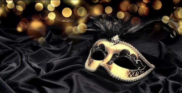 Beautiful venitian carnival mask on dark fabric