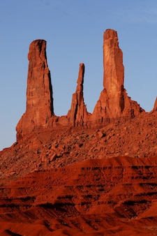 Beautiful vertical shot of sandstone rock formations at the oljato-monument valley in utah, usa