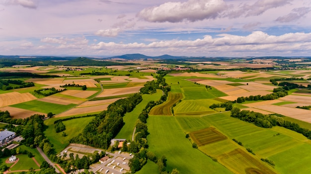 Beautiful view of agricultural fields and blue sky with white clouds. aerial view.