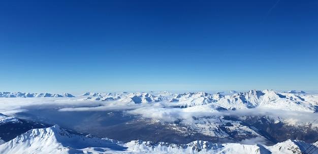 Beautiful view on alpine french snowy peak mountain