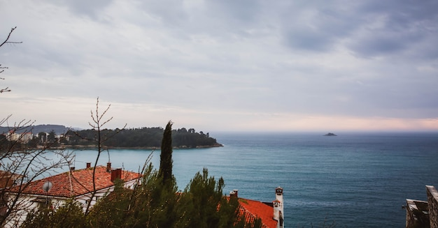 Beautiful view of the ancient city, the island and the sea on which the ship sails. rovinj, istria, croatia
