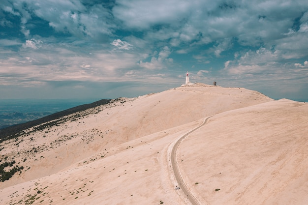 Beautiful view of a building on a hill under the cloudy sky in mont ventoux, france